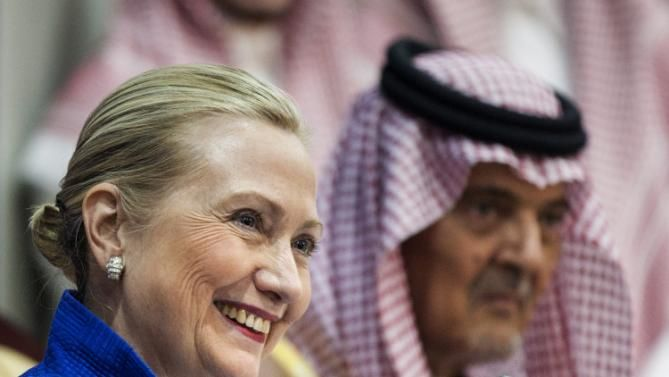FILE - In this Saturday, March 31, 2012, file photo, U.S. Secretary of State Hillary Clinton smiles during a joint press conference with Saudi Foreign Minister Prince Saud al-Faisal following a U.S.-Gulf Cooperation Council forum at the GCC secretariat in Riyadh, Saudi Arabia. WikiLeaks' publication of more than 60,000 Saudi documents has set pens racing across the Middle East with disclosures about the secretive Arab monarchy's foreign affairs. (AP Photo/Brendan Smialowski, Pool, File)