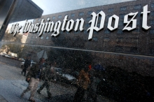 FILE - In this file photograph taken Nov. 1, 2007, the masthead of The Washington Post is displayed on the office building, in Washington. The Washington Post Co. is reporting a surge in second-quarter earnings, helped by a big jump in profits at its education division and lower expenses. (AP Photo/Charles Dharapak, file)