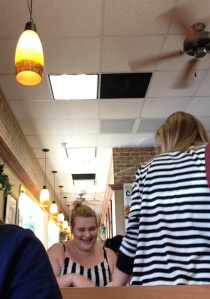 Customers at Subway wearing black & white stripes.